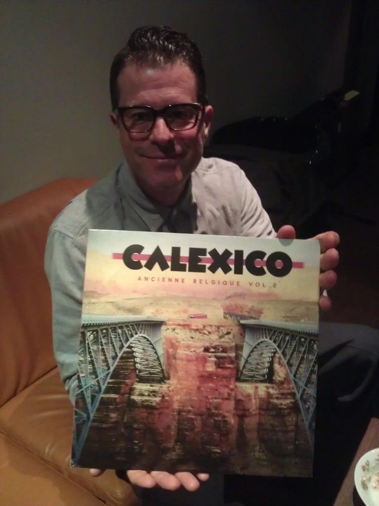 John Convertino of Calexico holding the vinyl LP of the new Ancienne Belgique Volume 2